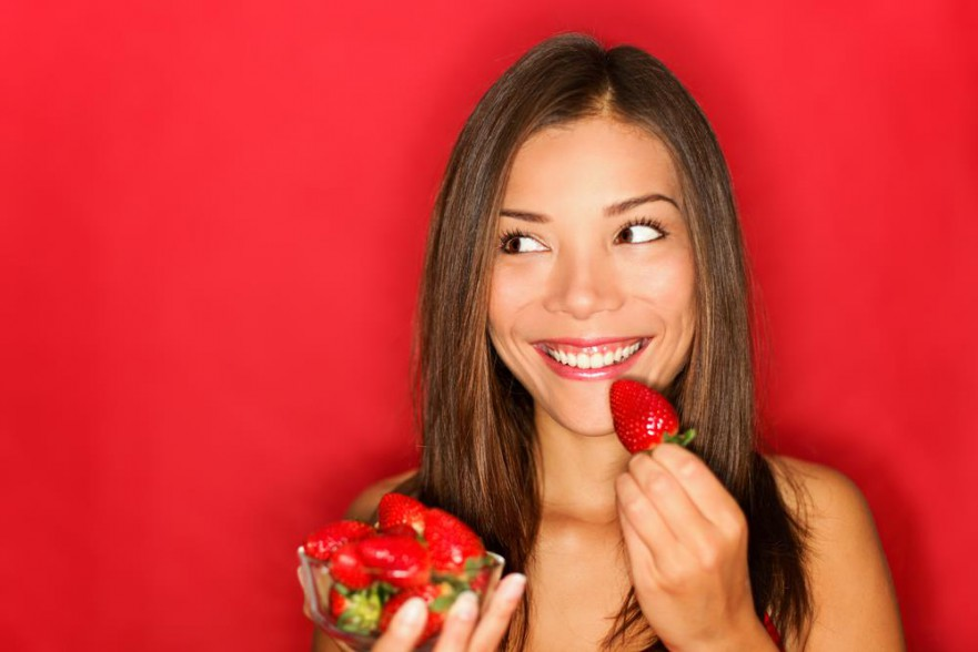 Healthy Snacks For Weight Loss - Woman Eating Strawberry